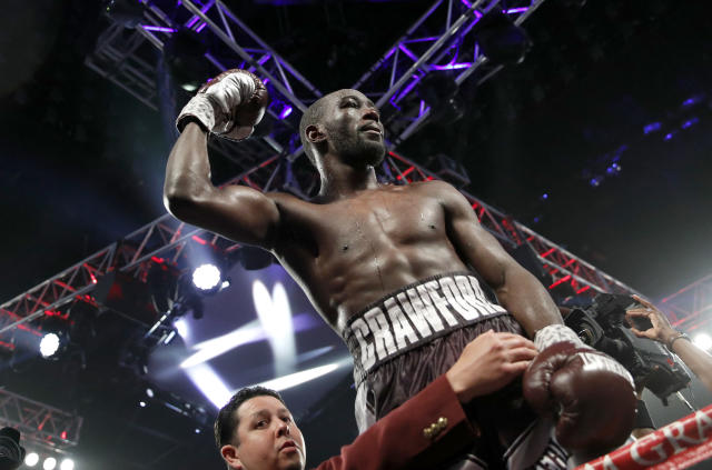 FILE - In this June 9, 2018, file photo, Terence Crawford celebrates after defeating Jeff Horn, of Australia, in a welterweight title boxing match in Las Vegas. Crawford wanted to fight three times this year. It's hard enough to find one guy to give him a real fight, which is what Lithuanias Egidijus Kavaliauskas will try to do Saturday when Crawford defends his welterweight title at Madison Square Garden (AP Photo/John Locher, File)