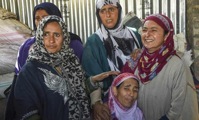 Village women console the mother of minor boy Aatif Ahmad, who was killed while being held hostage by two LeT militants in Hajin. PTI