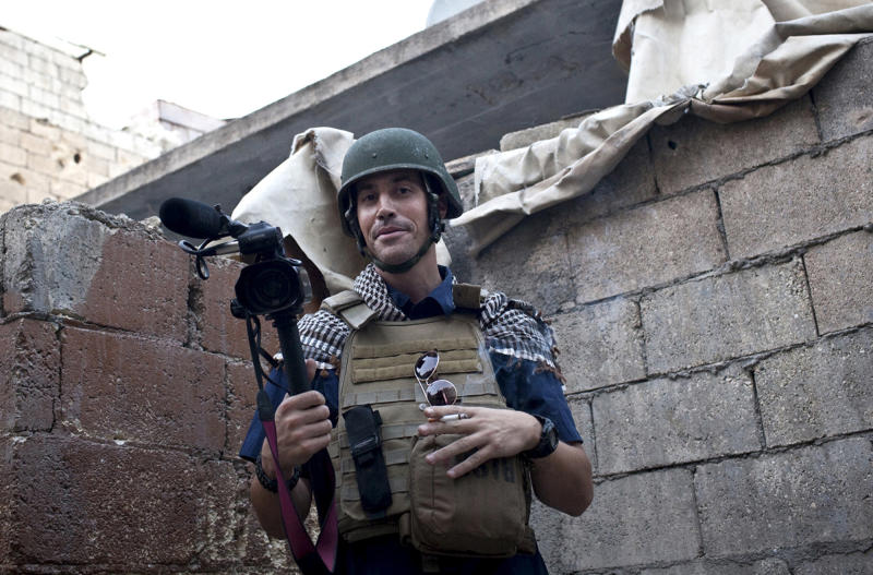 FILE - In this November 2012, file photo, posted on the website freejamesfoley.org, shows missing journalist James Foley while covering the civil war in Aleppo, Syria. American freelance journalist Foley disappeared in November 2012. Behind a veil of secrecy, at least 30 journalists have been kidnapped or have disappeared in Syria – held and threatened with death by extremists or taken captive by gangs seeking ransom. (AP Photo/Nicole Tung, freejamesfoley.org, File) NO SALES