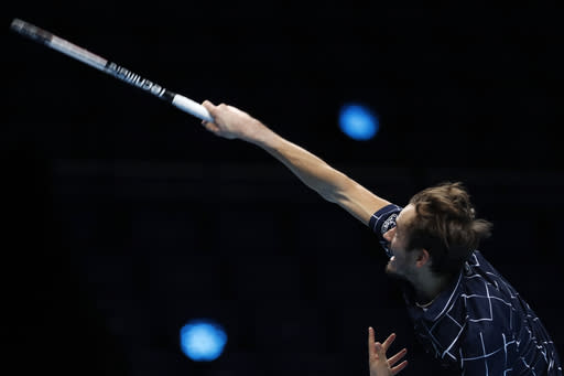Daniil Medvedev of Russia serves to Dominic Thiem of Austria during their singles final tennis match at the ATP World Finals tennis tournament at the O2 arena in London, Sunday, Nov. 22, 2020. (AP Photo/Frank Augstein)