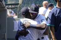 Seattle Mariners' Kyle Lewis, left, is greeted by Taylor Trammell before a baseball game Tuesday, April 20, 2021, in Seattle. (AP Photo/Ted S. Warren)