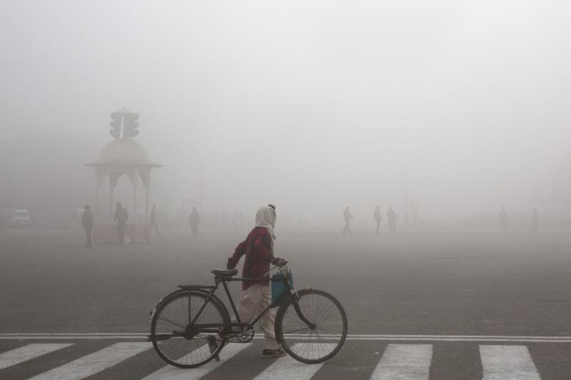 FILE - This Jan. 18, 2019 file photo shows a cyclist amidst morning smog in New Delhi, India. The climate talks in Madrid entered choppier waters Wednesday with ministers struggling to agree on rules for a global carbon market and possible ways to compensate vulnerable countries for disasters caused by global warming.(AP Photo/Manish Swarup, File)