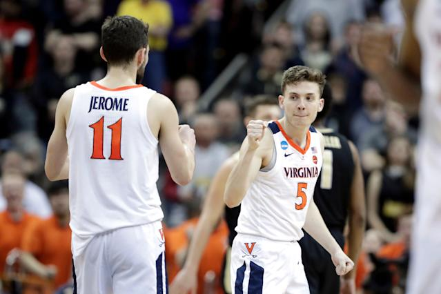 Virginia's Ty Jerome and Kyle Guy are both excellent halfcourt offensive players. (AP)