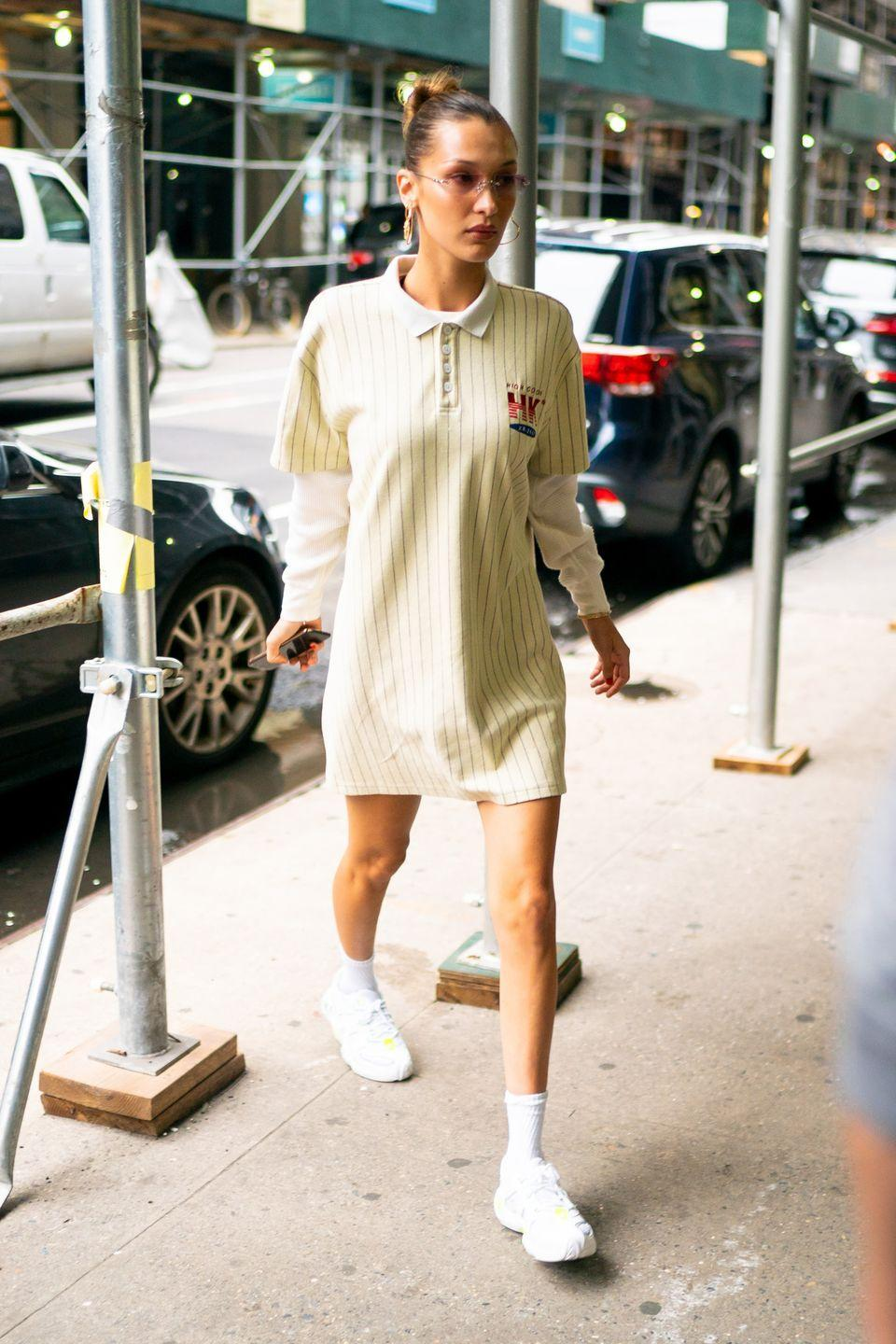 <p>Ransack your local thrift store (or your dad's closet) to nail this first day of school outfit. An oversized polo becomes the perfect dress, thanks to some trendy accessories. </p>
