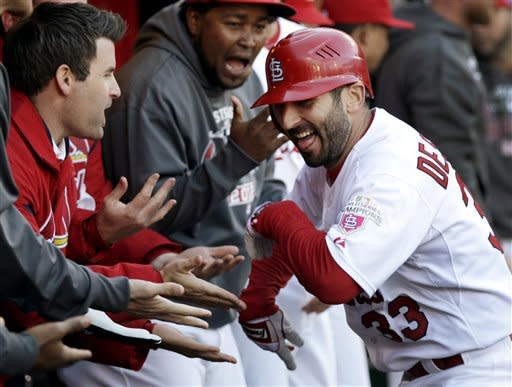 St. Louis Cardinals' Daniel Descalso is congratulated by teammates in the dugout after hitting a solo home run during the fourth inning in Game 2 of baseball's National League division series against the Washington Nationals, Monday, Oct. 8, 2012, in St. Louis. (AP Photo/Tom Gannam)