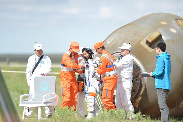 INNER MONGOLIA, CHINA - JUNE 26: (CHINA OUT) Chinese astronaut Wang Yaping waves after getting out of the re-entry capsule of China's Shenzhou X spacecraft following its successful landing at the main landing site on June 26, 2013 in Inner Mongolia Autonomous Region of China. The Astronauts return after a 15-day trip to a prototype space station. (Photo by ChinaFotoPress/ChinaFotoPress via Getty Images)