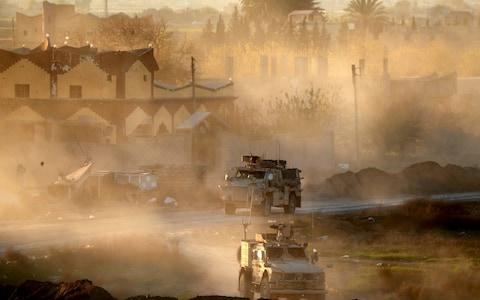 US army vehicles supporting the Syrian Democratic Forces in Hajin, in the Deir Ezzor province, eastern Syria, December 15, 2018. - Credit: DELIL SOULEIMAN/AFP