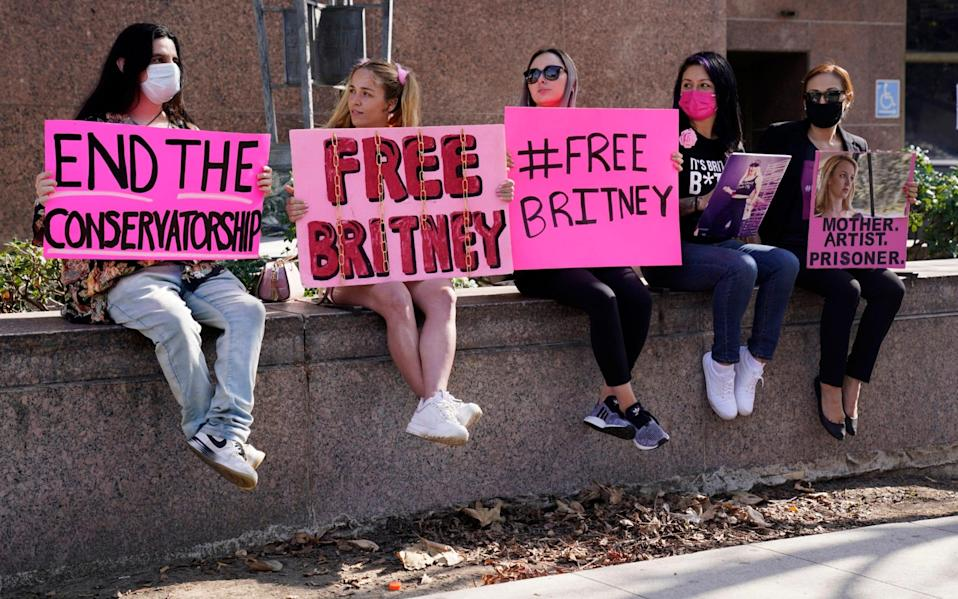 Britney Spears supporters gather outside a court hearing concerning the pop singer's conservatorship at the Stanley Mosk Courthouse - Chris Pizzello/AP