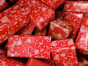 """<p>Challenge your party guests to see who can wrap a present the fastest. The catch? They must work in pairs and each person can only use one hand!</p><p><strong>Get the tutorial at <a href=""""https://www.partygameideas.com/siamese-gift-wrap-game/"""" rel=""""nofollow noopener"""" target=""""_blank"""" data-ylk=""""slk:Party Game Ideas"""" class=""""link rapid-noclick-resp"""">Party Game Ideas</a>.</strong></p><p><strong><a class=""""link rapid-noclick-resp"""" href=""""https://www.amazon.com/Image-Arts-Christmas-Wrapping-Reverse/dp/B073ZXHQB1/?tag=syn-yahoo-20&ascsubtag=%5Bartid%7C10050.g.22718533%5Bsrc%7Cyahoo-us"""" rel=""""nofollow noopener"""" target=""""_blank"""" data-ylk=""""slk:SHOP WRAPPING PAPER"""">SHOP WRAPPING PAPER</a><br></strong></p>"""