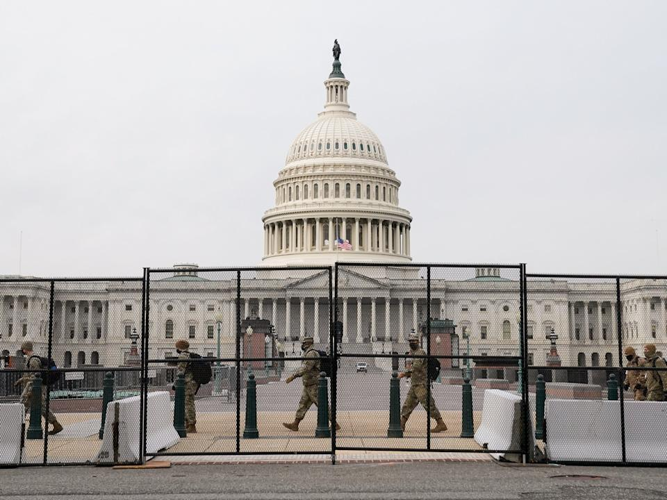 <p>Security fencing surrounds the US Capitol days after supporters of US President Donald Trump stormed the Capitol in Washington, US</p> (REUTERS)
