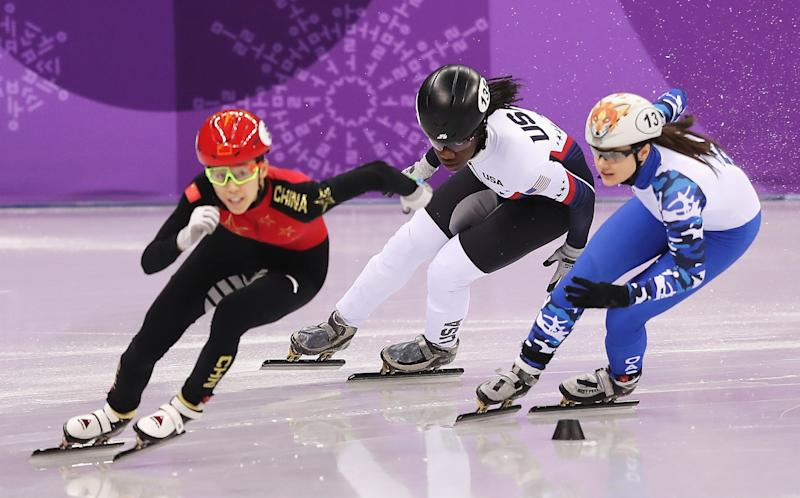 Maame Biney (center) couldn't advance in her 500 meter short-track quarterfinal. (Richard Heathcote via Getty Images)