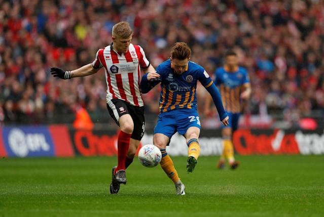 "Soccer Football - Checkatrade Trophy Final - Lincoln City vs Shrewsbury Town - Wembley Stadium, London, Britain - April 8, 2018 Shrewsbury Town's Jon Nolan shoots at goal Action Images/Andrew Boyers EDITORIAL USE ONLY. No use with unauthorized audio, video, data, fixture lists, club/league logos or ""live"" services. Online in-match use limited to 75 images, no video emulation. No use in betting, games or single club/league/player publications. Please contact your account representative for further details."