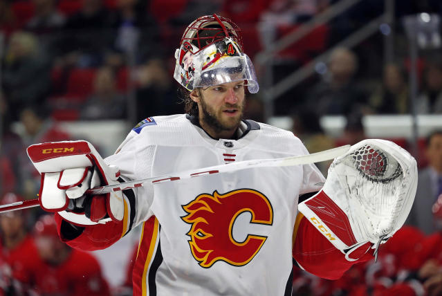 FILE - In this Jan. 14, 2018, file photo, Calgary Flames goaltender Mike Smith (41) returns to the net during the second period of an NHL hockey game against the Carolina Hurricanes in Raleigh, N.C. Smith is encouraged but says it's premature to determine when hell be cleared to play after practicing Tuesday, March 6, 2018, with the team for the first time in nearly a month since sustaining a lower body injury. (AP Photo/Karl B DeBlaker, File)