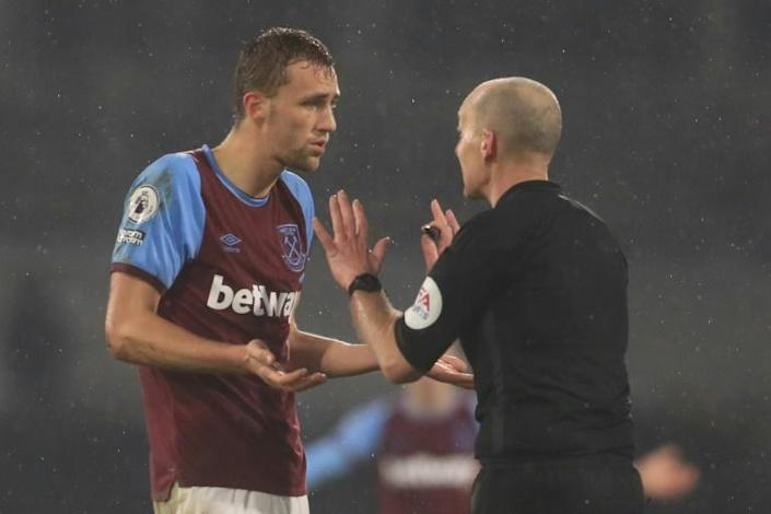 West Ham's Tomas Soucek (left)was sent-off by referee Mike Dean (right)in a much-criticised decision