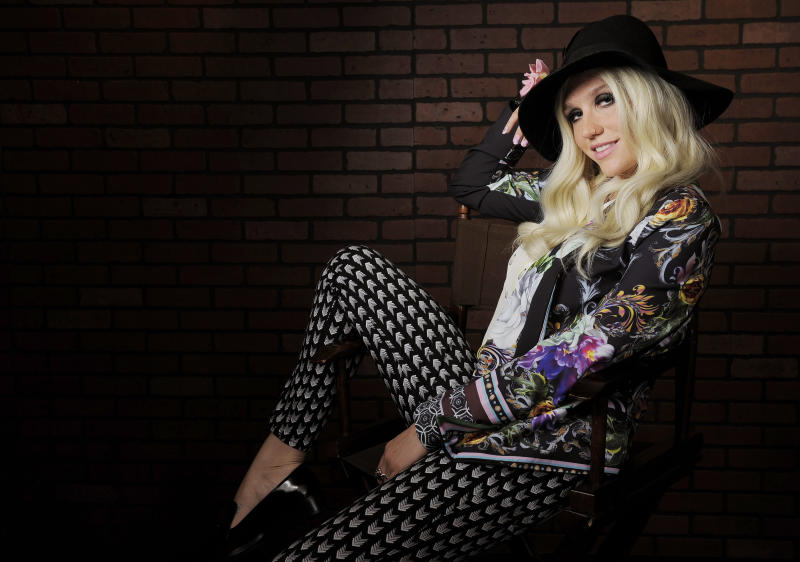 In this Tuesday, Nov. 13, 2012 photo, singer-songwriter Ke$ha poses for a portrait in Los Angeles. Becoming one of pop's top-selling acts over the past two years hasn't changed Ke$ha much, the girl who got famous by celebrating the trashy life is still reveling in it. (Photo by Chris Pizzello/Invision/AP)