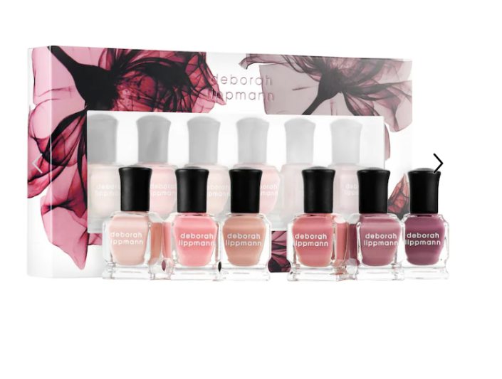 """<p><strong>Deborah Lippmann</strong></p><p>sephora.com</p><p><strong>$36.00</strong></p><p><a href=""""https://go.redirectingat.com?id=74968X1596630&url=https%3A%2F%2Fwww.sephora.com%2Fproduct%2Fbed-roses-nail-polish-set-P416422&sref=https%3A%2F%2Fwww.prevention.com%2Fbeauty%2Fg37678990%2Fbest-nail-polish-gift-sets%2F"""" rel=""""nofollow noopener"""" target=""""_blank"""" data-ylk=""""slk:SHOP NOW"""" class=""""link rapid-noclick-resp"""">SHOP NOW</a></p><p>The only thing better than giving your beauty-obsessed loved one a gift card to Sephora? Wrapping up this six-piece bed of roses nail polish set in a cute box so they can get a rosy-hued mani-pedi anytime. Among the shades, they'll find full coverage and sheer options.</p>"""