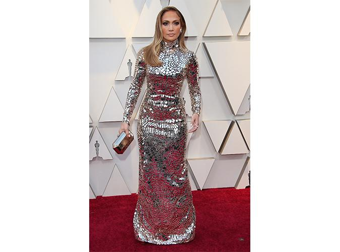 <p>We've never seen anything quite like this metallic embroidered mirror mosaic long-sleeved gown. (Talk about a mouthful).</p>