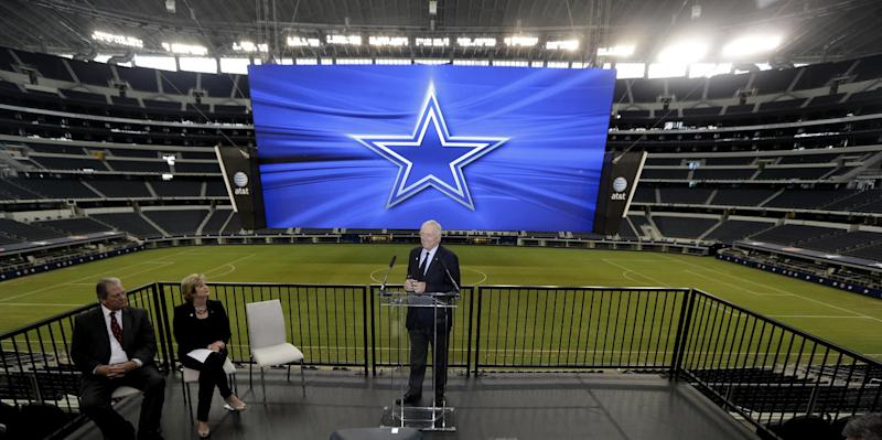 Dallas Cowboys owner Jerry Jones, right, speaks as AT&T senior vice president Cathy Coughlin, center left, and Arlington Mayor Robert Cluck look on during news conference announcing the naming of the Dallas Cowboys Stadium to AT&T Stadium Thursday, July 25, 2013, in Arlington, Texas. The terms of the naming deal were not released. (AP Photo/LM Otero)