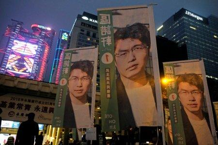 Banners showing portraits of pro-democracy candidate Au Nok-hin are displayed during an election campaign at the financial Central district in Hong Kong, China March 3, 2018. Picture taken March 3, 2018. REUTERS/Bobby Yip