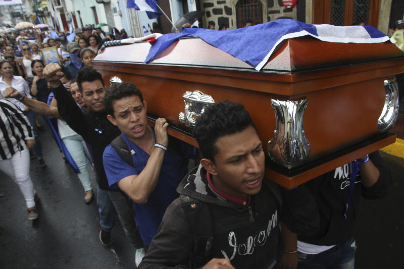 Men carry the coffin of Eddy Montes Praslin to a church before his burial in Matagalpa, Nicaragua, Sunday, May 19, 2019. Montes Praslin, a Nicaraguan-American dual national who died in a prison disturbance in Nicaragua, served in the U.S. Navy and was a staunch opponent of the government of President Daniel Ortega, according to his cousin Marvin Montes. (AP Photo/Oscar Duarte)