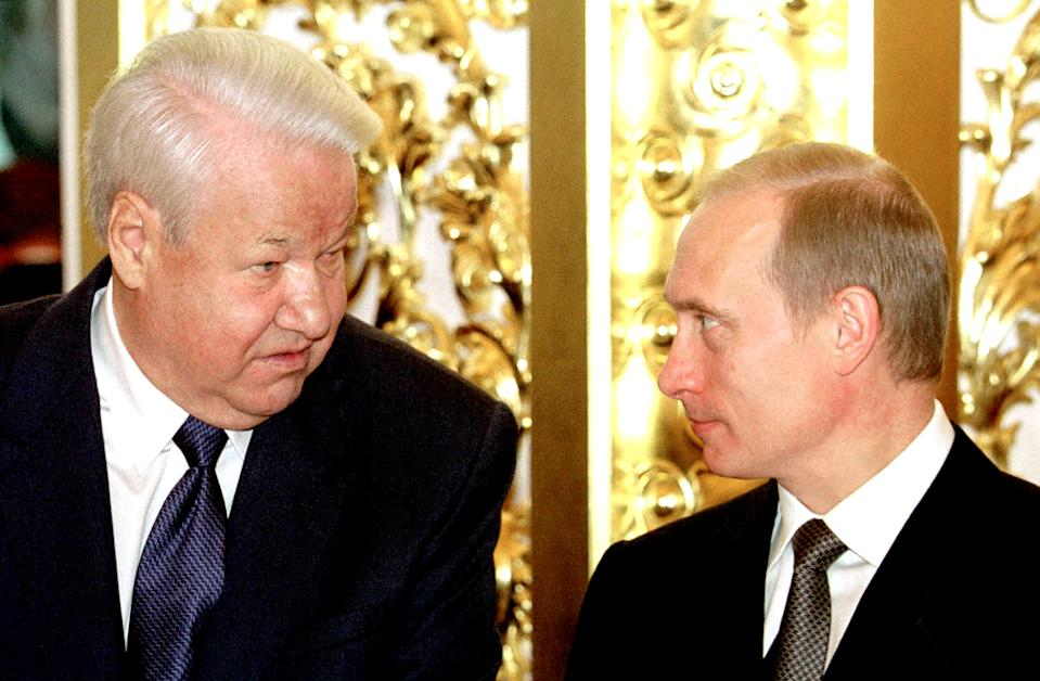 Vladimir Putin, right, and Boris Yeltsin