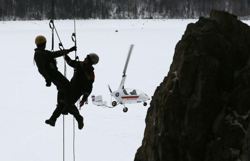 Rescuer Borisova and her colleague Savinich attend a training session on the bank of the Yenisei River outside Krasnoyarsk