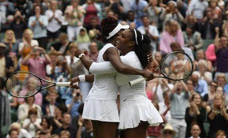 Britain Tennis - Wimbledon - All England Lawn Tennis & Croquet Club, Wimbledon, England - 9/7/16 USA's Serena Williams and Venus Williams celebrate winning their womens doubles final against Hungary's Timea Babos and Kazakhstan's Yaroslava Shvedova REUTERS/Tony O'Brien