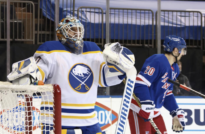Buffalo Sabres' Carter Hutton (40)s pauses following a second-period goal by New York Rangers' Chris Kreider, right, during an NHL hockey game Tuesday, March 2, 2021, in New York. (Bruce Bennett/Pool Photo via AP)