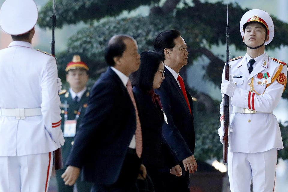 Former Vietnam's Prime Minister Nguyen Tan Dung, second right, arrives for the opening ceremony of the 13th National Congress of Vietnam's Communist Party (VCP), in Hanoi, Vietnam, Tuesday, Jan. 26, 2021. (AP Photo/Minh Hoang)