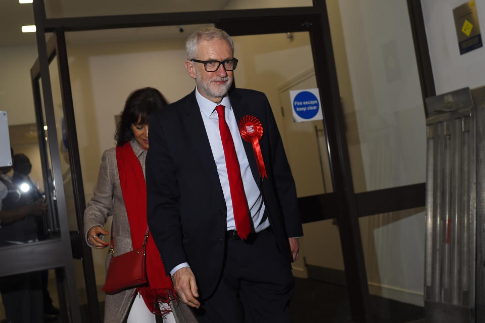 LONDON, ENGLAND - DECEMBER 13: Jeremy Corbyn, leader of the Labour Party, and his wife Laura Alvarez leave Labour headquarters on December 13, 2019 in London, England. The current Conservative Prime Minister Boris Johnson called the first UK winter election for nearly a century in an attempt to gain a working majority to break the parliamentary deadlock over Brexit. As the results roll in the Conservative Party have made huge gains from around the country at the expense of the Labour party. Votes will be counted overnight and an overall result is expected on Friday. (Photo by Peter Summers/Getty Images)