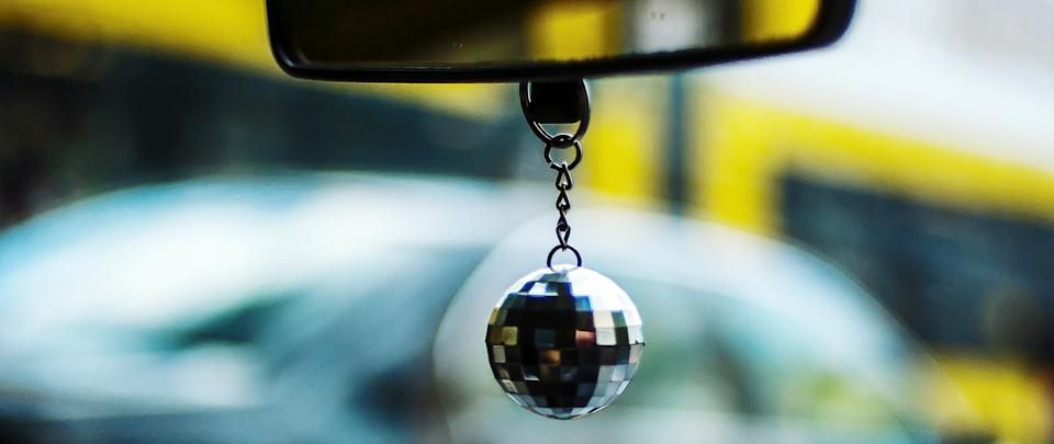 Disco ball hanging from car mirror. Source: Getty Images