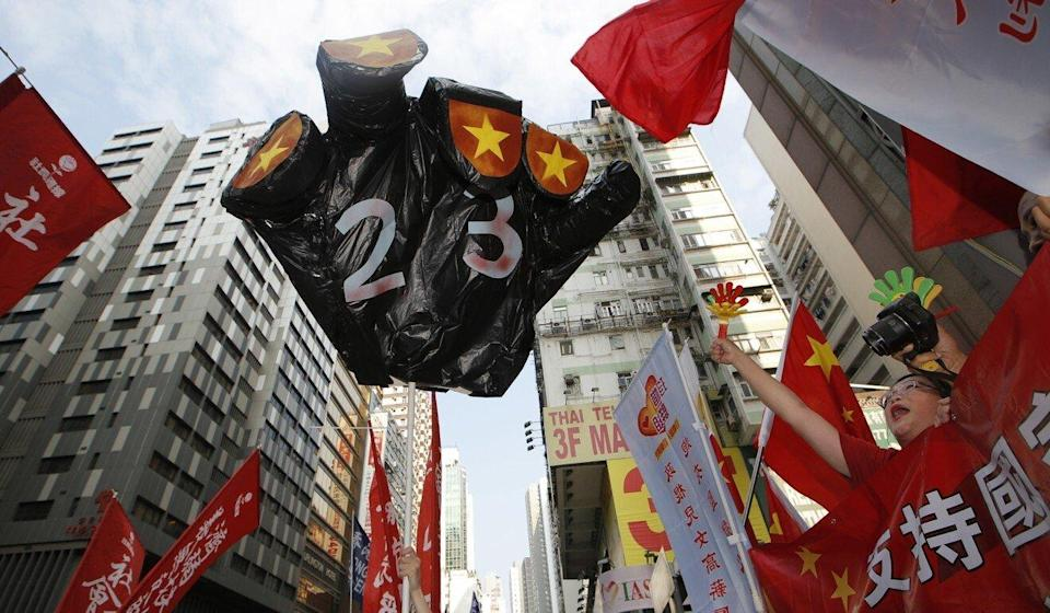 Protesters hold a mock black hand with the number '23' as they clash with pro-Beijing people during a rally to mark National Day in Hong Kong, in 2018. Photo: AP