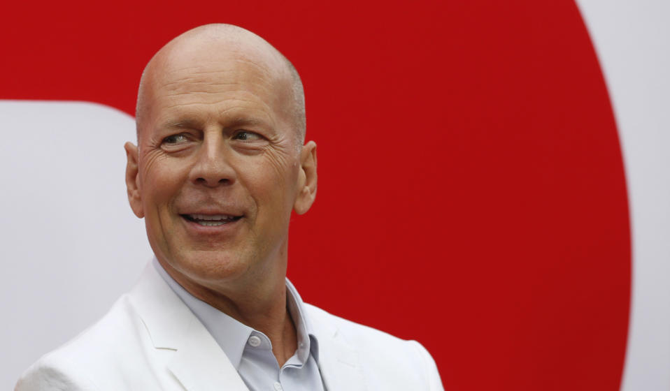 """Cast member Bruce Willis poses at the premiere of the film """"Red 2"""" in Los Angeles, California July 11, 2013. The movie opens in the U.S. on July 19. REUTERS/Mario Anzuoni (UNITED STATES - Tags: ENTERTAINMENT)"""