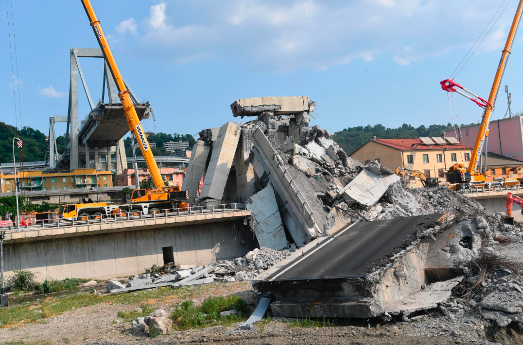 <em>At least 43 people were killed when the bridge collapsed during a storm (AP)</em>
