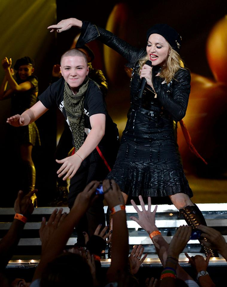 Who's that guy? It's Madonna's 12-year-old son Rocco, who joined her on stage on Tuesday in Philadelphia, the first stop on the North American leg of her MDNA tour. Rocco's dad is Madonna's second husband, British filmmaker Guy Ritchie. (8/28/2012)
