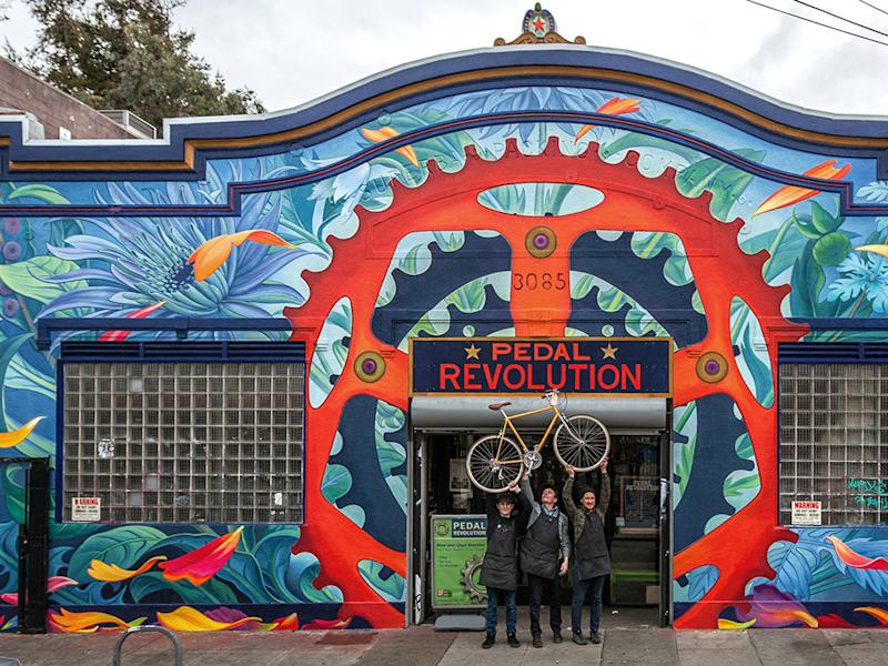Mona Caron, Swiss-born artist and Upper Market resident, painted a mural on Pedal Revolution's storefront in 2017.