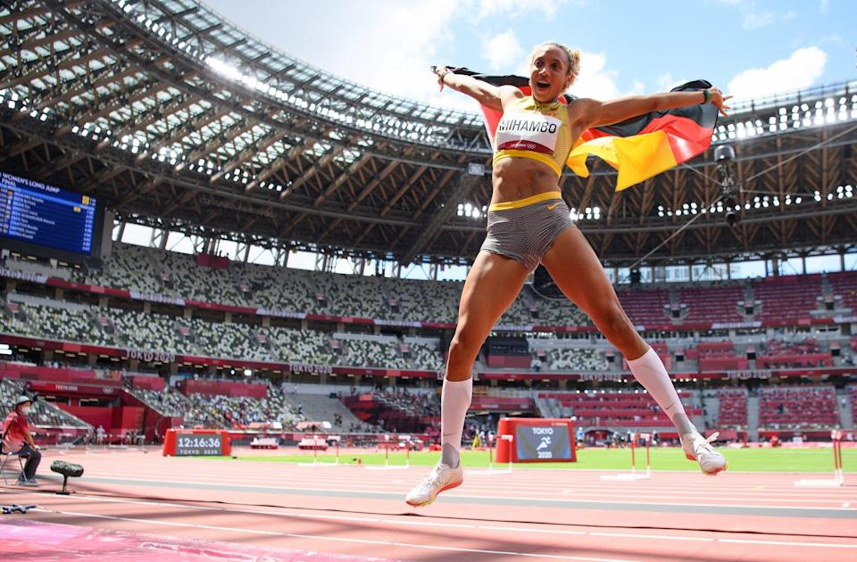 <p>Malaika Mihambo of Team Germany jumps with her country's flag after winning the gold medal in the Women's Long Jump Final at Olympic Stadium on August 3.</p>