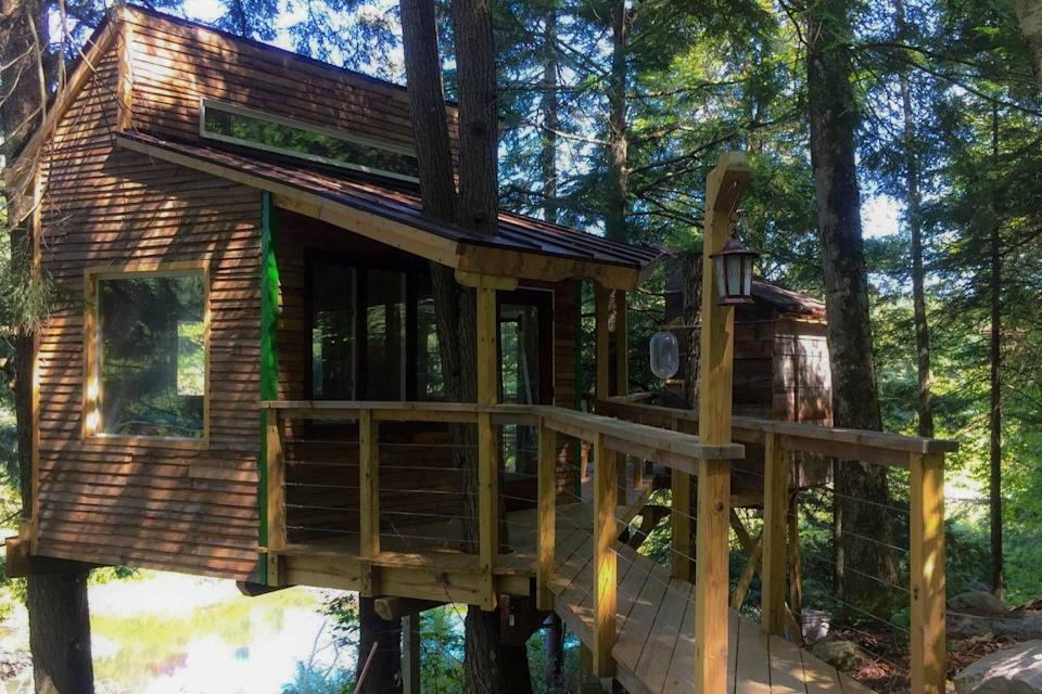 """<p>Central Vermont is graced with the Green Mountain National Forest, and this elevated abode embraces the area's natural beauty. The log cabin–style house overlooks a beaver pond and sits in close proximity to Killington and Sugarbush resorts, where avid skiers can hit the slopes.</p><p><a class=""""link rapid-noclick-resp"""" href=""""https://www.airbnb.com/rooms/14495355"""" rel=""""nofollow noopener"""" target=""""_blank"""" data-ylk=""""slk:BOOK NOW"""">BOOK NOW</a> <strong><em>The Beaver Pond Treehouse</em></strong><br></p>"""