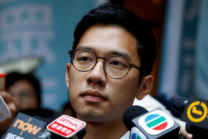 FILE PHOTO: Pro-democracy activist Nathan Law is interviewed by journalists outside the Final Court of Appeal after being granted bail in Hong Kong