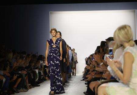 Models present creations from Michael Kors Spring/Summer 2014 collection during New York Fashion Week, September 11, 2013. REUTERS/Joshua Lott