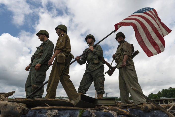From left to right, Caleb Cobb, Bryan Querrey, Alexx Cobb and Eric Voiers, of the Ripley Tabernacle Baptist Church, prepare to portray the Iwo Jima flag raising photo for the annual Independence Day parade in Ripley, W.Va., on July 4, 2019. (Photo: Craig Hudson/Charleston Gazette-Mail via AP)