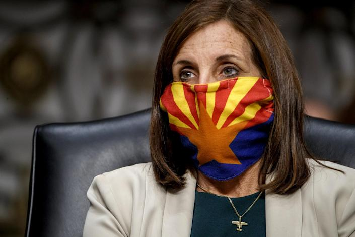 Image: Sen. Martha McSally, R-AZ, listens to testimony at a hearing at the Capitol on May 6, 2020. (Shawn Thew / Getty Images file)