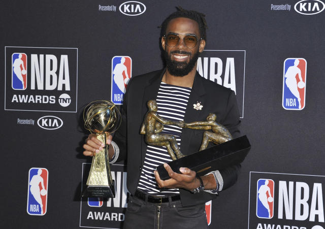 NBA player Mike Conley Jr., of the Memphis Grizzlies, poses in the press room with the NBA teammate award and sportsmanship of the year award at the NBA Awards on Monday, June 24, 2019, at the Barker Hangar in Santa Monica, Calif. (Photo by Richard Shotwell/Invision/AP)