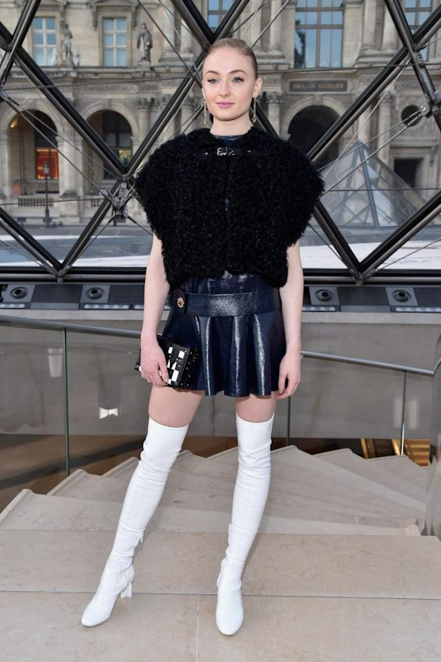 <p>Sophie Turner stood out in a mini dress and white thigh high boots. <i>[Photo: Getty]</i> </p>