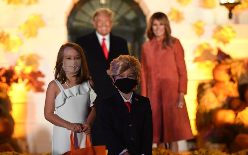Trump was particularly pleased with a young boy with a distinctly Trump head of hair and a partner who did her best Mrs. Trump impersonation - AFP