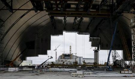 A general view shows the construction of the New Safe Confinement (NSC) structure at the site of the Chernobyl nuclear reactor, Ukraine, March 23, 2016. REUTERS/Gleb Garanich