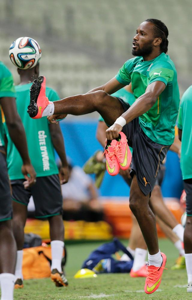 Ivory Coast's Didier Drogba controls a ball during on official training session the day before the group C World Cup soccer match between Greece and Ivory Coast at the Arena Castelao in Fortaleza, Brazil, Monday, June 23, 2014. Ivory Coast should beat Group C strugglers Greece, but even a draw won't hold them back as long as Japan doesn't upset Colombia. (AP Photo/Fernando Llano)
