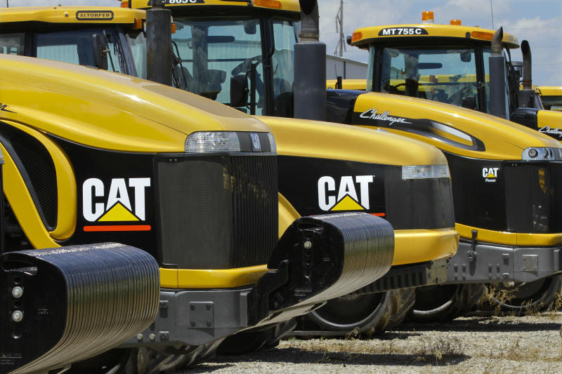 "FILE - In this Wednesday, June 20, 2012, file photo, shows Caterpillar logos on earth moving tractors and equipment in Clinton, Ill. Caterpillar cut its profit and revenue guidance on Monday, Oct. 22, 2012, saying the world's economic conditions ""are weaker than we had previously expected."" Caterpillar Inc. is the world's largest construction and mining equipment maker, so its results are watched closely as a sign of where the broader economy is headed. (AP Photo/Seth Perlman)"
