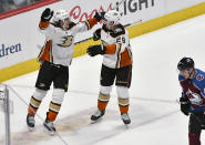 Anaheim Ducks left wing Rickard Rakell (67) celebrates his overtime goal with defenseman Christian Djoos (29), as Colorado Avalanche defenseman Samuel Girard (49) skates by during an NHL hockey game Wednesday, March 4, 2020, in Denver. The Ducks won 3-2 in overtime. (AP Photo/John Leyba)