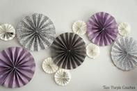 "<p>These paper pinwheels are easy to make, and oh-so versatile. Group them as a photo backdrop or party decor, or string them together in a garland. Use traditional red and green for Christmas (or whatever other colors you like to adapt to any occasion).</p><p><em><a href=""http://twopurplecouches.com/2015/01/how-to-make-paper-pinwheels/"" rel=""nofollow noopener"" target=""_blank"" data-ylk=""slk:Get the tutorial at Two Purple Couches»"" class=""link rapid-noclick-resp"">Get the tutorial at Two Purple Couches»</a></em><br></p>"